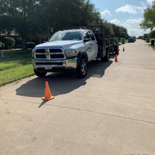 brown foundation repair work truck parked at customer's home in dallas, tx