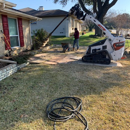 foundation repair using auger on home exterior