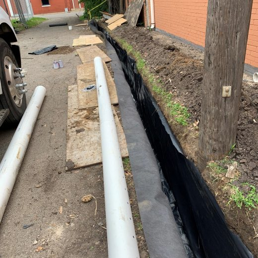 moisture barrier installation in dallas, tx for drainage project