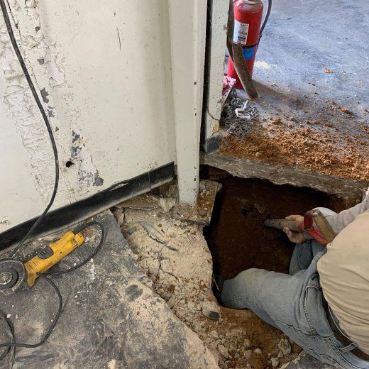 slab broken for interior foundation repair in warehouse